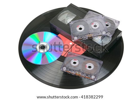 Vinyl disc, audio and video cassettes isolated on white background - stock photo