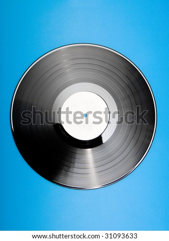 Vinyl disc with blank label on blue background