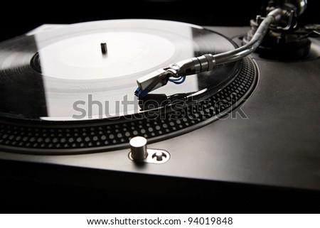 Vinyl disk player in backlight - stock photo