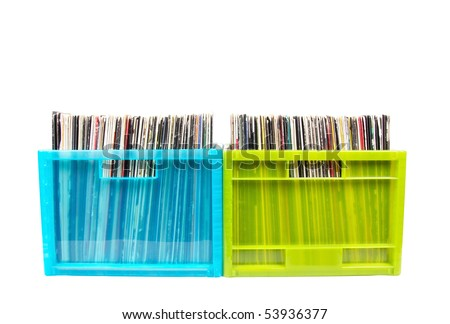Vinyl disks in plastic boxes isolated on white, closed-up - stock photo