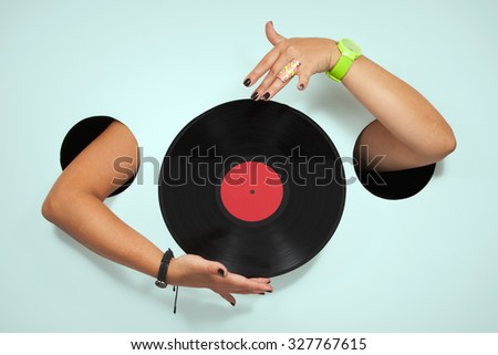 Vinyl in a female hands - stock photo