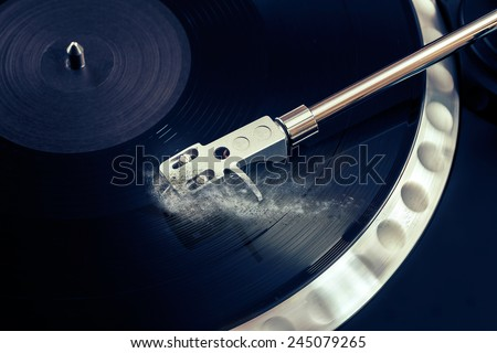 vinyl laying on a record player - scratching the surface - nightclubbing, dj etc  - stock photo