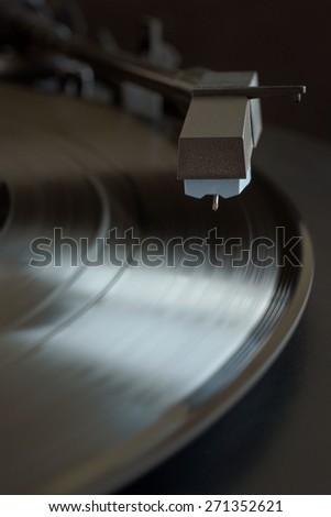 Vinyl LP and record player stylus in low key light and selective focus - stock photo