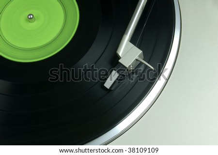 Vinyl record being played on phonograph - stock photo