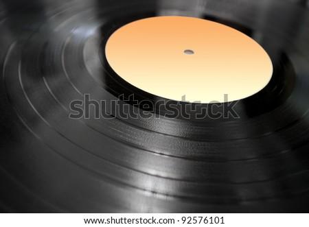 vinyl record lying in perspective - stock photo