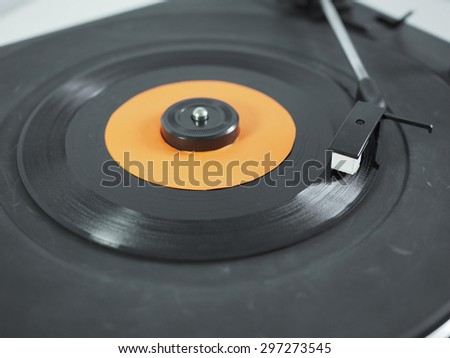 Vinyl record on a turntable record player, single 45rpm disc