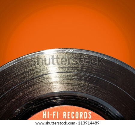 Vinyl record on red background - stock photo