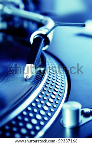 Vinyl record player playing the music - stock photo