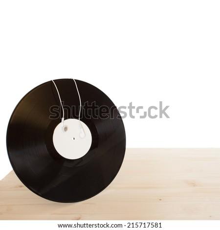 vinyl with headphones on wooden table  - stock photo