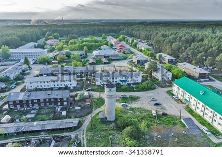 Vinzili, Russia - May 25, 2015: Aerial view onto Sosnovaya Street in settlement serving lunatic asylum with water tower on foreground - stock photo