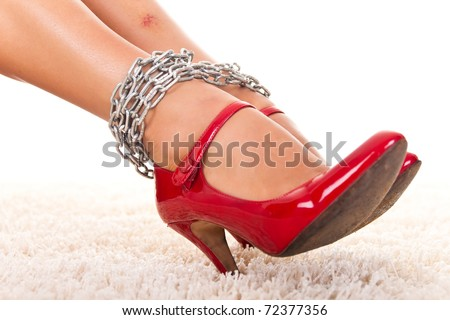 violated women's legs with  bruise in chains, close up - stock photo