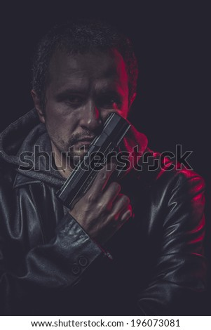 Violence Assassin, man with black coat and gun - stock photo