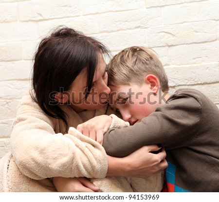 Violence  in the family. Mother  soothes her son - stock photo