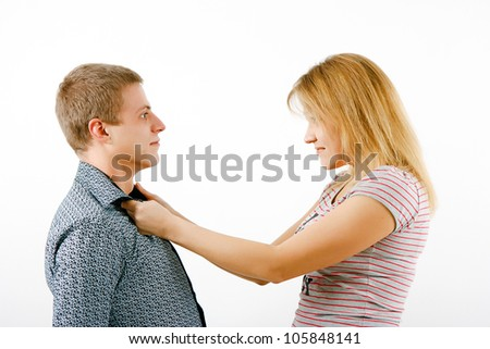 Violence in the family. Wife beats husband - stock photo