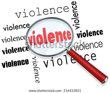 Violence word under magnifying glass to illustrate research or investigation into causes of violent acts - stock photo