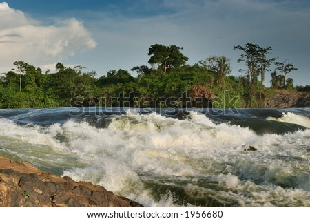 Violent rapid Bujagali falls in upper of Nile - stock photo