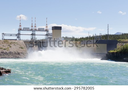 Violent white water in spillway of hydro-electric power plant of the small scale hydro station at Whitehorse, Yukon Territory, Canada