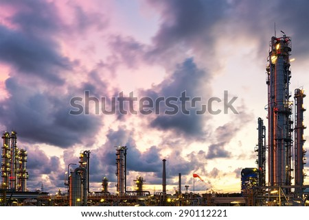 Violet and blue twilight sunset scene of oil and gas refinery plant skyline - stock photo