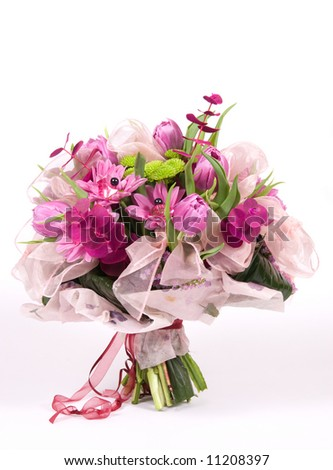 Violet bouquet made of varied beautiful flowers - stock photo