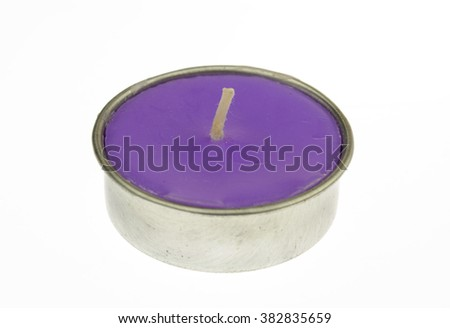 Violet candle isolated on white background - stock photo