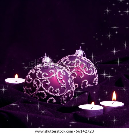 Violet Christmas Balls and Candles on Velvet - stock photo