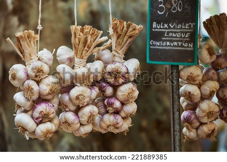 Violet garlic for sale at  farmers market in Aix en Provence, France - stock photo