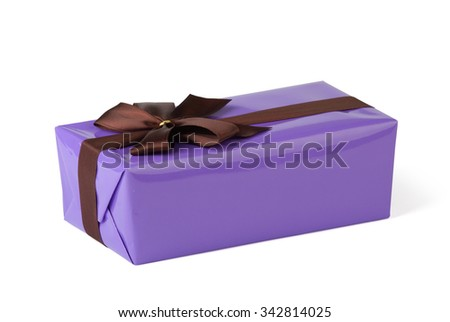 Violet gift box with ribbon isolated on white.