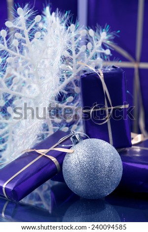 violet gift boxes white art snow flake blue color cast  - stock photo