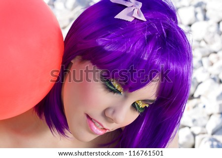 Violet-haired woman, young and happy latex balloon city red. - stock photo