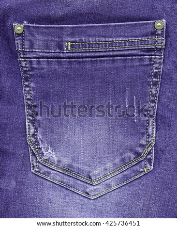 violet jeans back pocket on violet jeans background