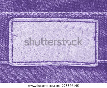 violet leather label on violet jeans background - stock photo