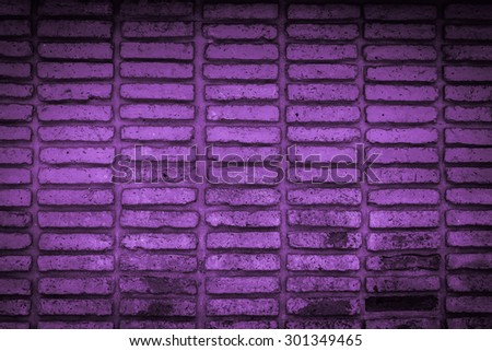 violet old brick wall texture background - stock photo