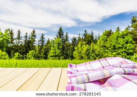 Violet tablecloth on wooden table