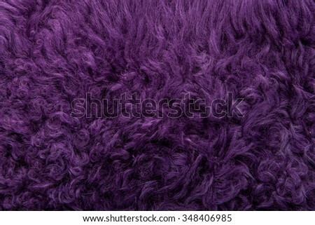 violet tanned leather texture, decorated with fur  - stock photo