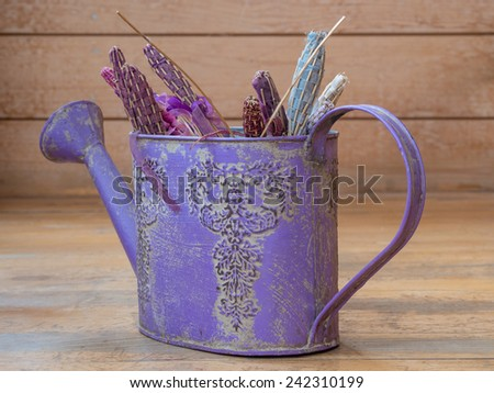 Violet watering can with lavender theme - stock photo