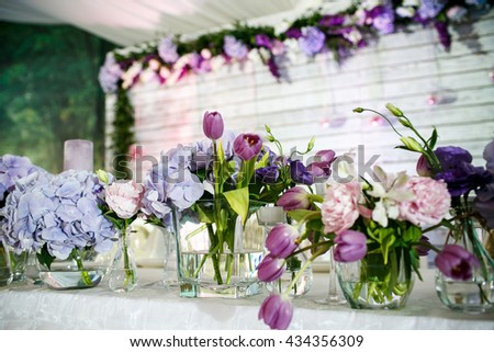 Violet wedding decoration with flowers