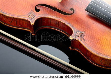 Violin and bow on dark background - stock photo