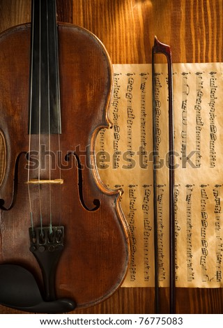 violin and fiddle stick on note - stock photo
