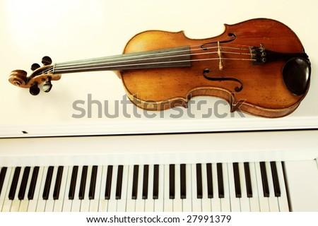 violin and piano keys - stock photo