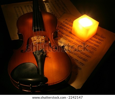 Violin and the candle - stock photo