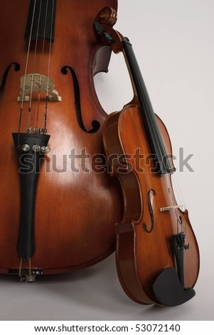 Violin and violoncello on a white background - stock photo