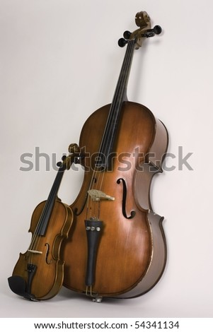 Violin and violoncello on a white background