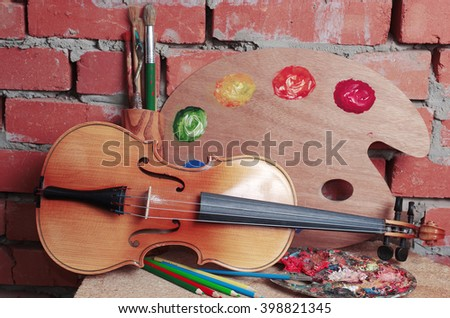 Violin, art palette and brushes