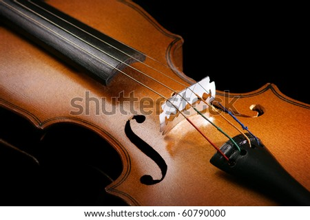Violin close up with a razor blade at the place of the bridge - stock photo