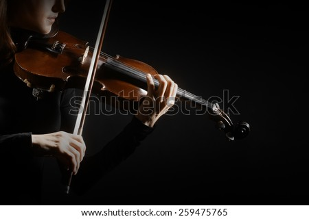 Violin closeup hands with music instrument Close up of player violinist  - stock photo