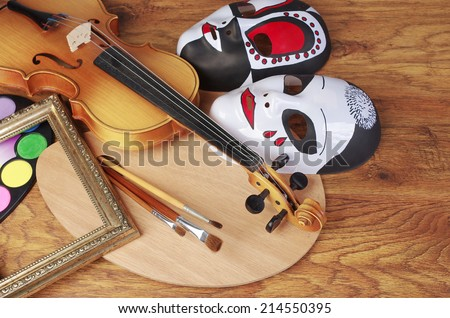 Violin, flute, art palette, frames, brushes and masks. Attributes of arts. - stock photo