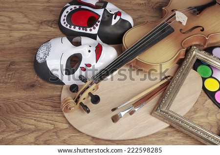 Violin, flute, art palette, frames, brushes and masks. Attributes of arts.