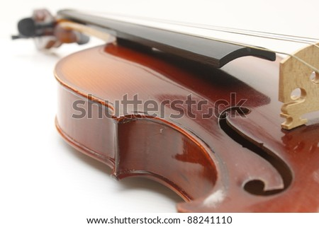 Violin instrument close up on white backgroung - stock photo