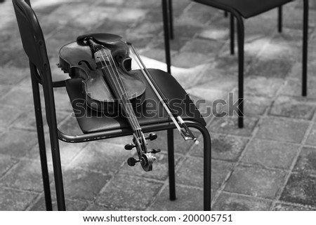 Violin is in the chair.