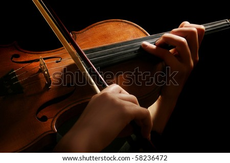 Violin music instrument violinist. Classical player hands. Details of violin playing isolated on black - stock photo